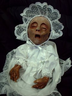 Ok.  This is a doll.  Check out this site: http://www.susanscustomcreepydolls.com/