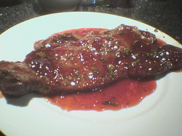 Steak with raspberry sauce