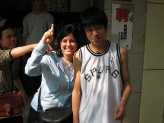 Spurs fan with his mom trying to remove his cigarette for the photo