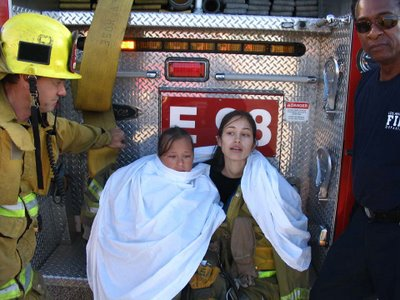 Members of LAFD Engine 98 comfort rescued girls. Photo by Evan Williams