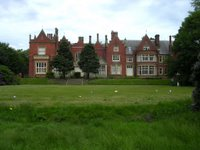 Abney Hall with crisp packets decorating the lawn