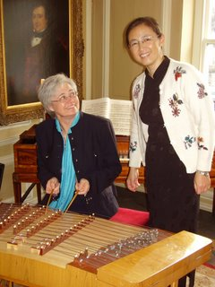 Cllr Sue Derbyshire recieves in struction on the playing of the gu zheng