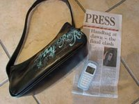 TradeMe auction pic of handbag and cellphone