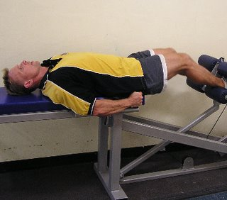 leg extended position of the HipneeFlex hip and knee flexor strength developer