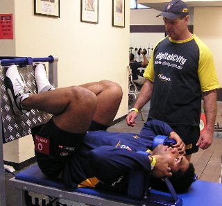 Sydney University strength coach Martin Harland supervising Jerry Yanuyanutawa on the HipneeThrust leg extensor strength developer