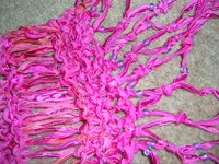 Really beautiful picture of pink scarf, in trellis effect with blue and purple beading on a fringe