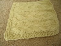 yellow hand-knit facecloth in dragon sclae pattern