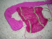 two pink scarves, one with a narrow regukar strip of apple green