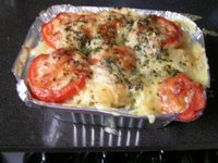 photo of home made macaroni and cheese, topped with tomatoes, parmesan and parsely