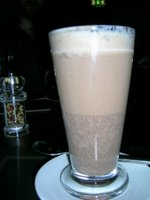 hot chocolate drink in glass latte cup