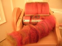 bad photo' of drum carder with carded fibre in foreground
