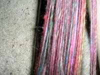 close up view of singles yarns in rust, pink, brown, orange, yellow