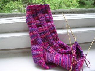 half-finished sock in Lorna's Laces pinks and purples combo