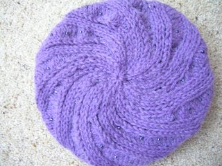 top down view of purple swirl odessa hat with grey metallic beads