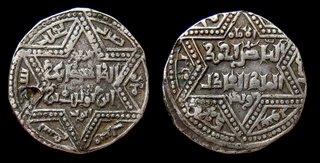 El Zahir en forma de moneda