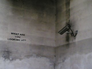 CCTV camera pointing at top of blank wall
