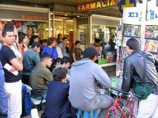 Uruguay world cup classificator, street crowd watching the game on tv