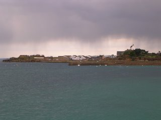 Roscoff, house over hill in a cloudy weather