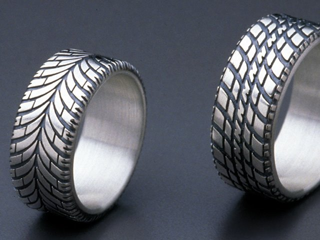 find the classic wedding band too stodgy looking for something with a bit more grip look not further than the tire ring from brian bergeron designs - Gear Wedding Ring