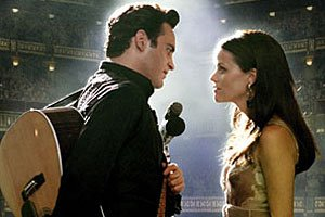 Joaquin Phoenix and Reese Witherspoon as Johnny Cash and June Carter in Walk The Line