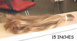 photo of a 15-inch long severed ponytail lying on a shelf, ready to be donated to Locks Of Love