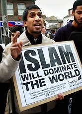 "Picture: Muslim holding a sign that says, ""Islam Will Dominate The World"""