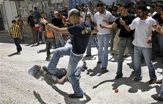 "Picture: ""Palestinians"" stomping on their recently executed fellow countrymen"