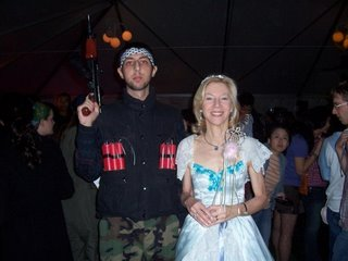 Picture: Saad Saadi in a suicide belt posing with Amy Gutmann