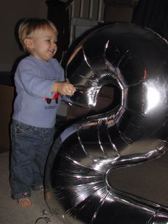 (J. with '2' balloon