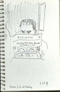 Man Reading Tabloid