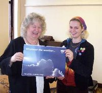 Jean Lambert MEP receiving a Climate Change Calendar from Flipside Vision