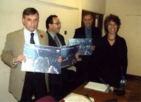 Lee Scott MP, Harry Cohen MP and Cllr Hugh Cleaver receiving a Climate Change Calendar from Flipside Vision