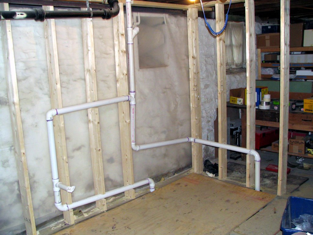 How to finish your basement a z for How to plumb a basement bathroom