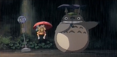 Totoro lands, Mei and Satsuki are bounced up