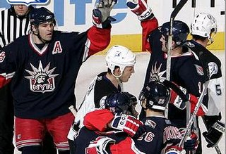Jagr congratulates Poti on his game-winning goal
