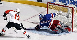 Kevin Weekes stops Jeff Carter in 3rd period - Rangers clinch playoff berth