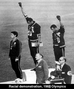 Tommie Smith(ctr) and John Carlos showing the Black Power salute in the 1968 Summer Olympics