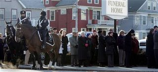 Mourners at St. Guillen wake
