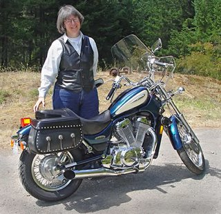 Robin Atkins, bead artist and her Suzuki motorcycle