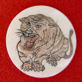 scrimshaw on bone, tiger button, Japanese