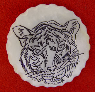 scrimshaw on mother-of-pearl, tiger button by Diane Schefferly