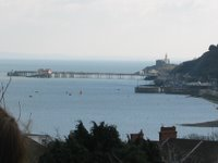A picture of Mumbles Pier as seen from Oystermouth Castle