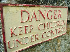 Iron sign, the text warns: Danger - Keep children under control
