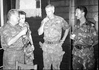 Bosnian Serb army Commander General Ratko Mladic, left, drinks a toast with Dutch UN Commander Tom Karremans, second right, during Srebrenica Massacre July 12, 1995.