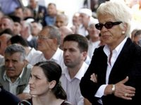 Chief Prosecutor of the Hague War Crime Tribunal, Carla Del Ponte, right, takes part in memorial ceremony at the funeral of 505 bodies at the Memorial Center Potocari, near Srebrenica north of the Bosnian capital Sarajevo, Tuesday, July 11, 2006. The bodies will be buried marking the 11th anniversary commemorations of the massacre. Serb troops killed over 8,000 Bosniak men and boys at Srebrenica in 1995. (AP Photo/Amel Emric)