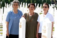 Srebrenica Massacre widows Zumra Sehomerovic, Kada Hotic and Sabaheta Fejzic (from left to right) in Bare cemetery, Sarajevo.