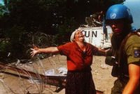 Bosnian Muslim woman asks U.N. soldier for help to prevent Srebrenica massacre. U.N. stood helpless while over 8,000 men and boys (children) were massacred by Serb forces on July 11th 1995.