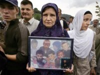 Srebrenica Mother Holds Photo of her Children who Perished During Srebrenica Massacre (Never Forget 7/11/1995 - Srebrenica Genocide)