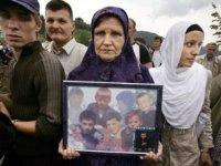 Srebrenica Mother Holds Photo of her Children who Perished During Srebrenica Massacre (Never Forget 7/11/1995 - Srebrenica Genocide)