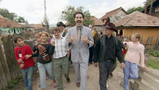 Cousin Borat near his home in Kazakhstan with neighbors